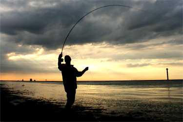 angler in the evening dusk